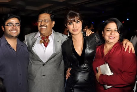 Chopra with her parents and brother in 2012