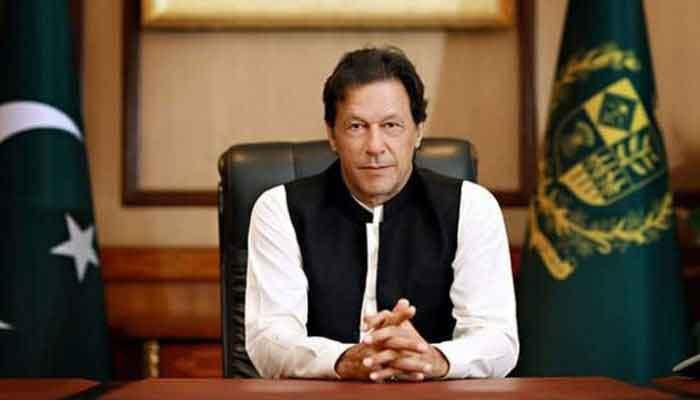 PM-Imran-Khan-flag_akhbar